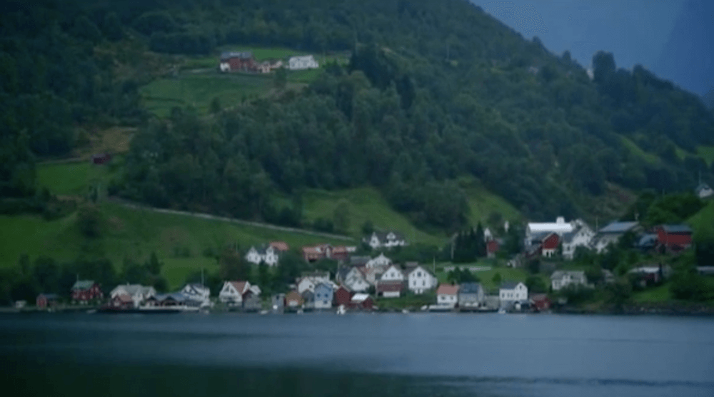 A small town in the fjords as seen from the Midnatsol
