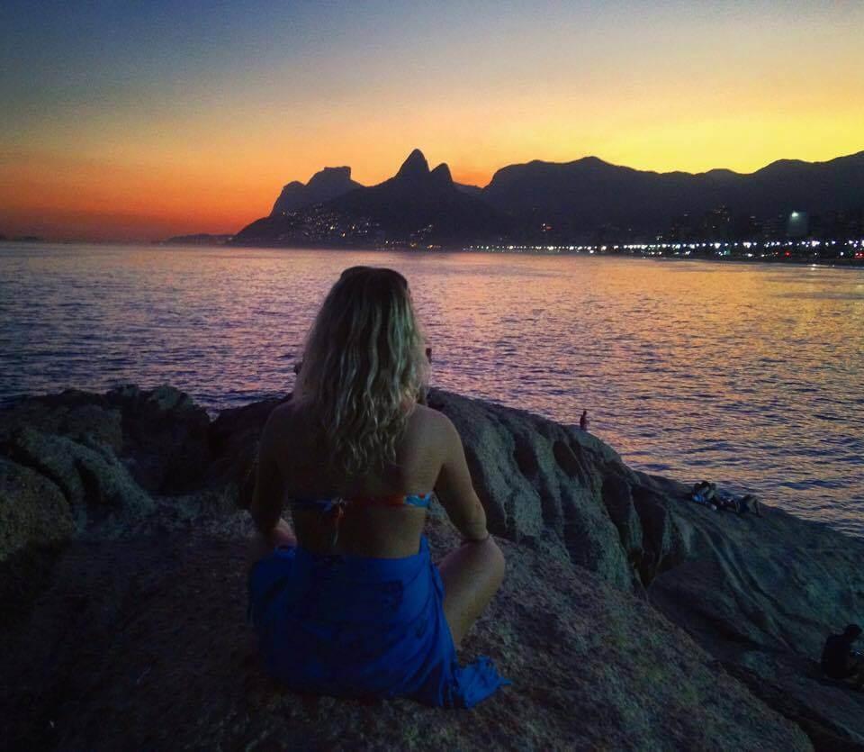 Watching the sun set from Ipanema and Arpoador