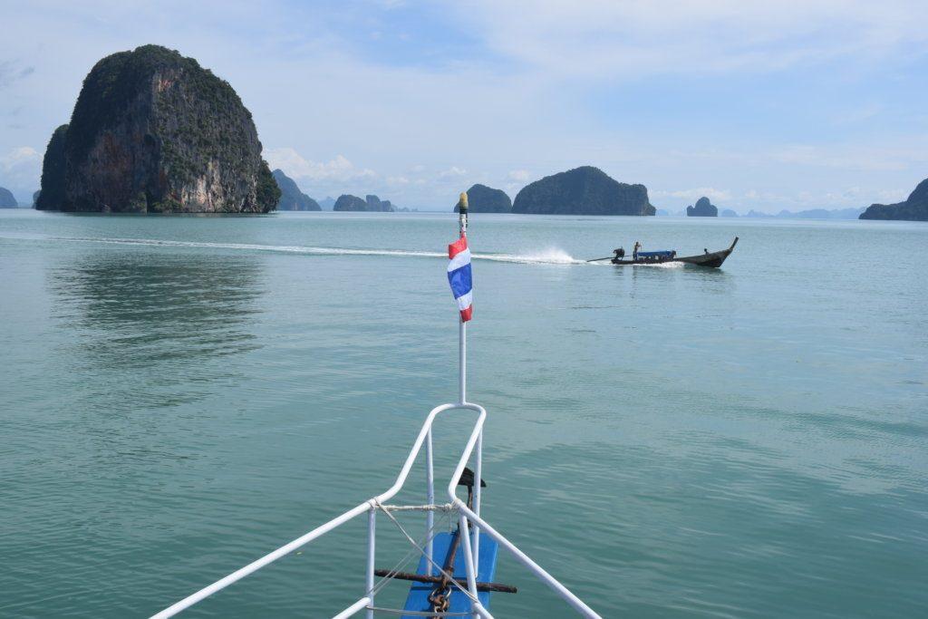Just a long tail boat speeding away in Phang Nga Bay