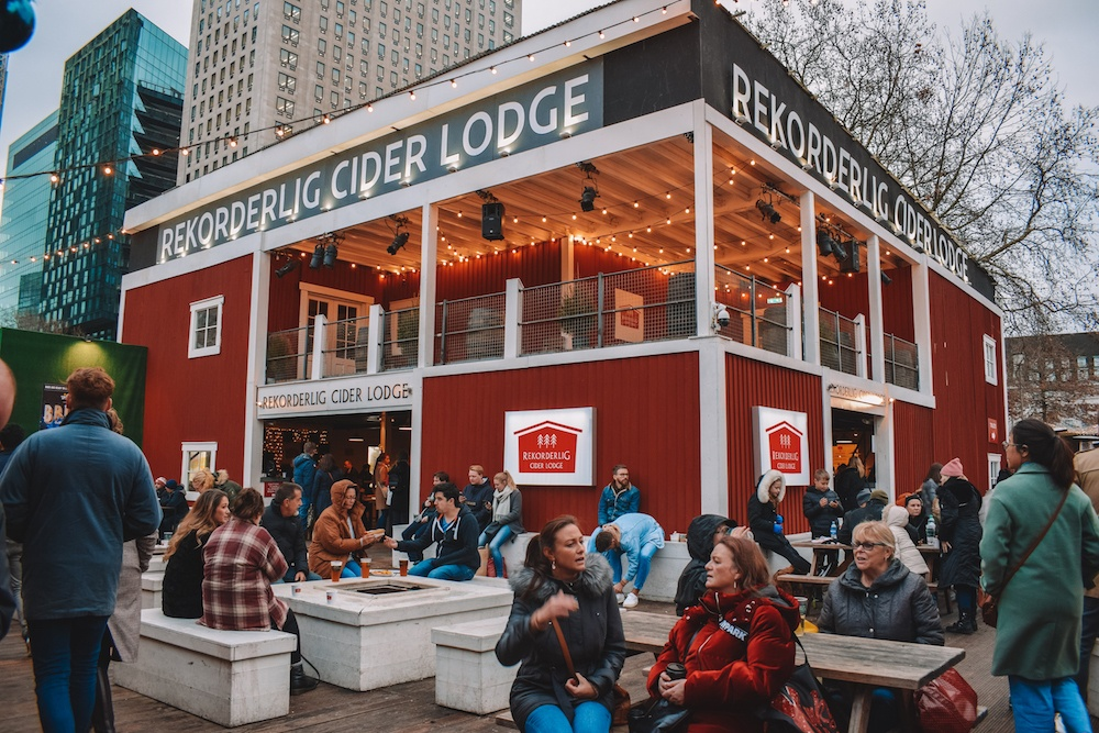 The Rekorderlig Cider Lodge in Southbank Christmas market, with the outdoor seating area where you can enjoy the Christmas street food