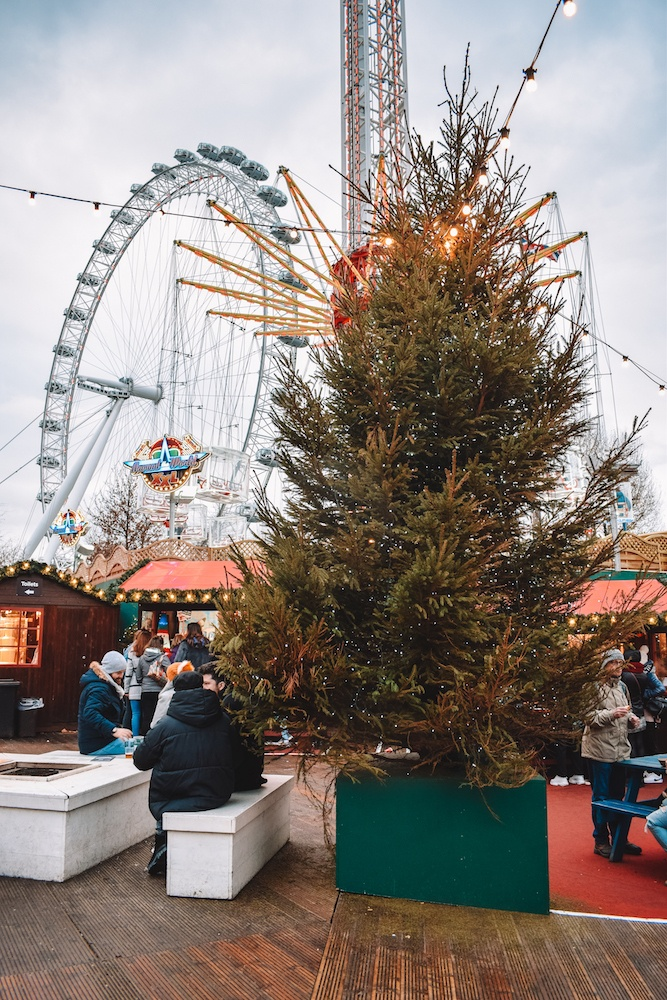 The Christmas tree at Southbank Christmas Market, with the London Eye in the background