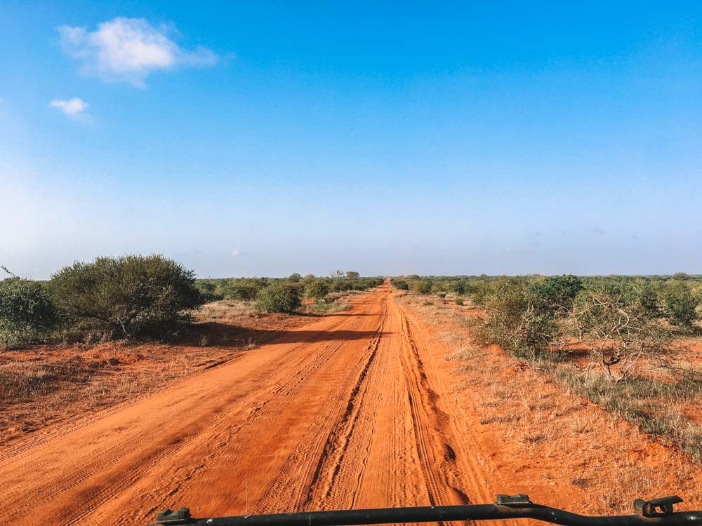 Driving on the tracks of the Tsavo East National Park, Kenya