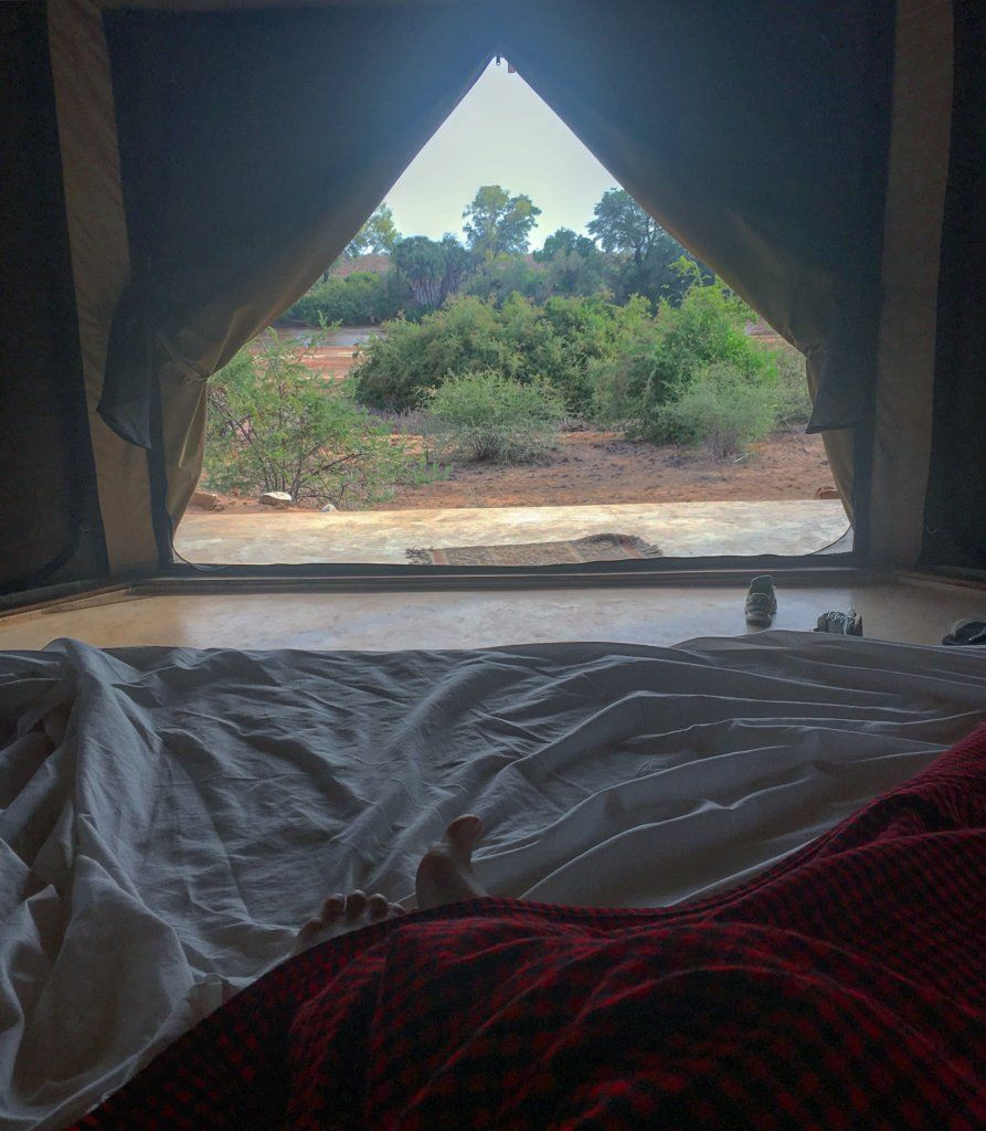 The view over the savannah from our bed and tent at the Swara Osteria Camp