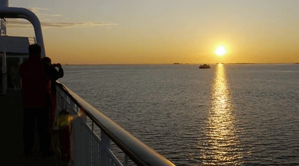 Watching the midnight sun from the deck of the Midnatsol, our Hurtigruten cruise boat