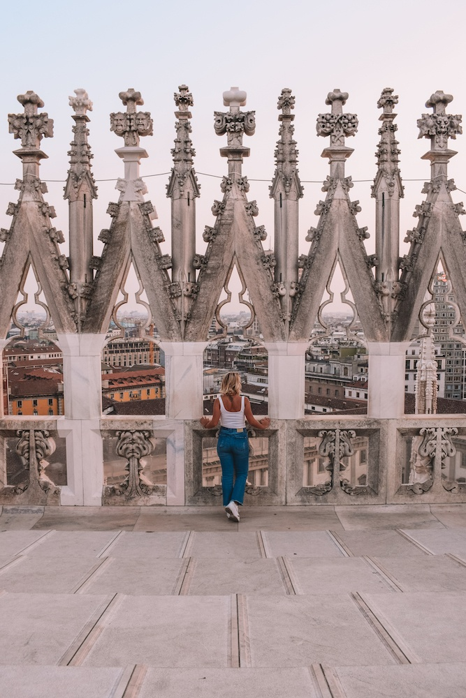 Exploring the rooftop of the Duomo cathedral in Milan, Italy