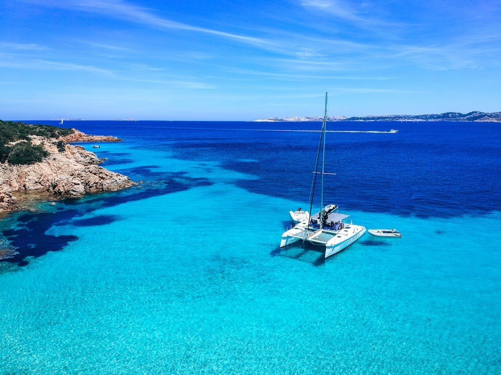 Sailing in Sardinia in JuneThe catamaran of Sport Outdoor Viaggi that we went sailing to Maddalena Archipelago with