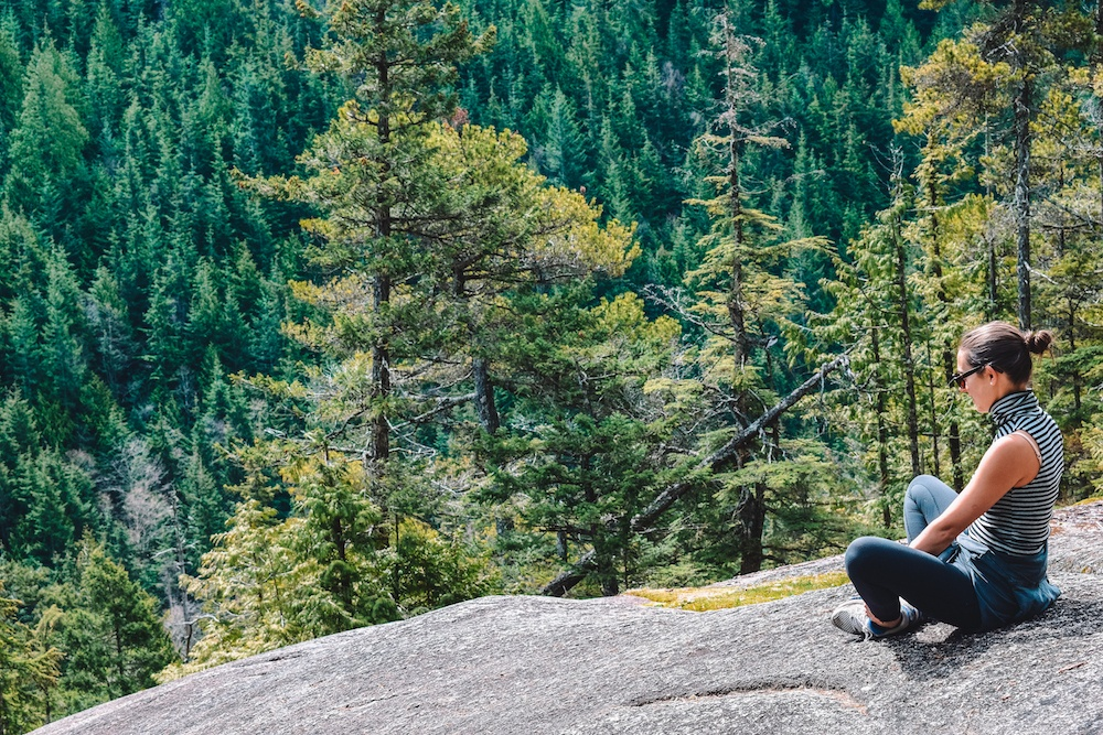 Taking a break while hiking Stawamus Chief during our Whistler road trip
