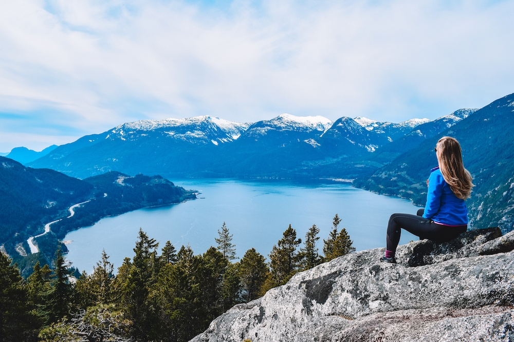 Enjoying the view from the top of the First Peak of Stawamus Chief in Canada