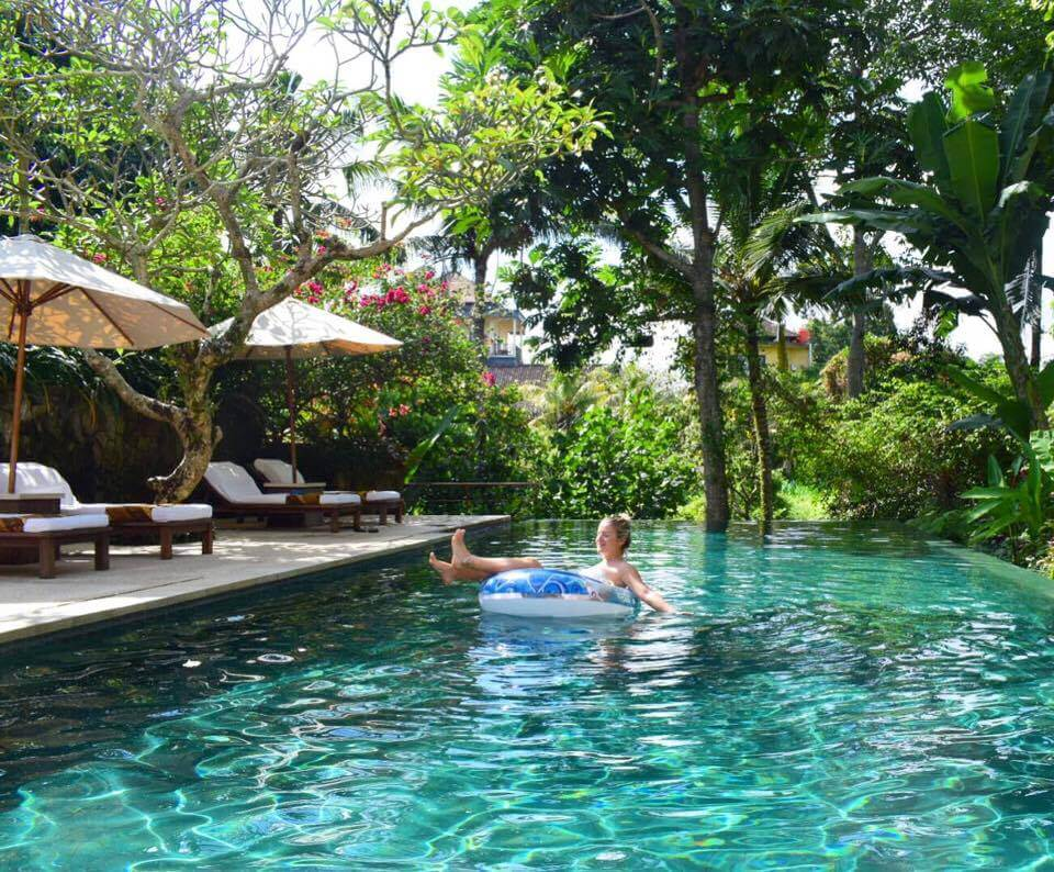 Chilling at the pool of our hotel, Komaneka at Monkey Forest