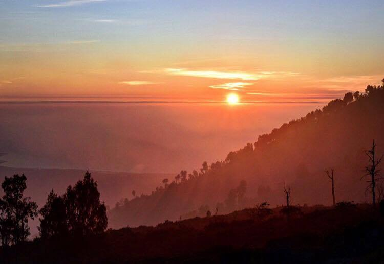 The sun breaks through and turns East Java pink