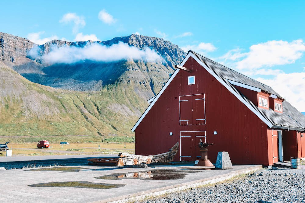 A red house on the outskirts of Patreksfjordur in the Westfjords, Iceland