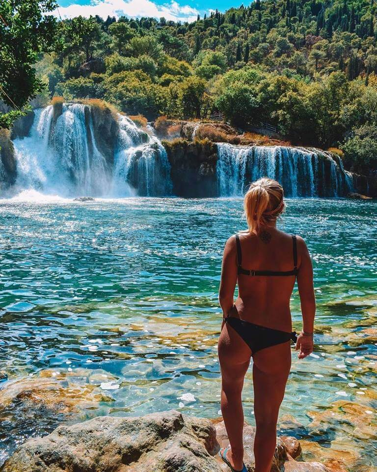 Looking for a corner away from the crowds by Krka waterfalls