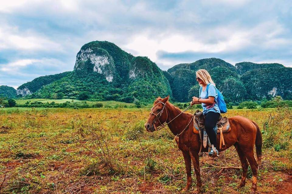 Me attempting to horse ride for the second time in my life in the valley of Viñales