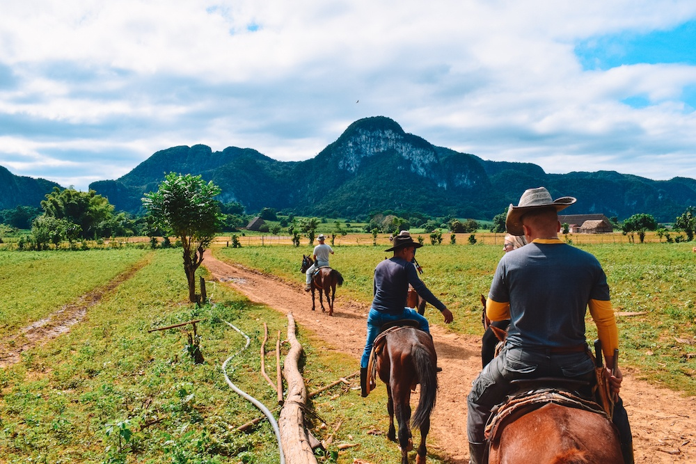 Horse riding in the valley of Vinales, Cuba.