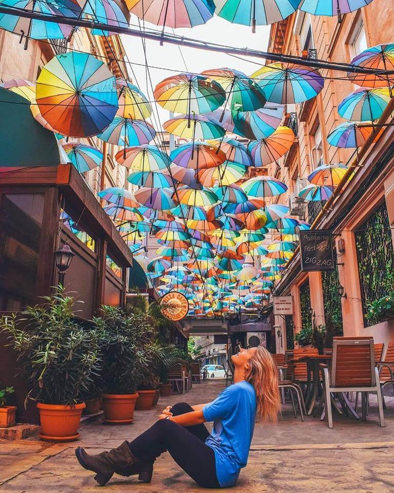 The colourful umbrella street in front of Pizza Colosseum in Bucharest, Romania
