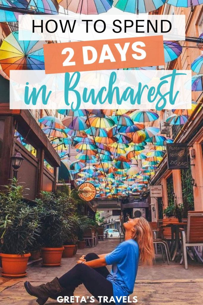 """Photo of a blonde girl sat in the colourful umbrella street in Bucharest with text overlay saying """"how to spend 2 days in Bucharest"""""""