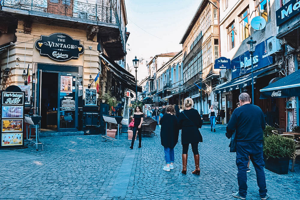 One of the bustling roads with cafes and restaurants of the Old Town of Bucharest
