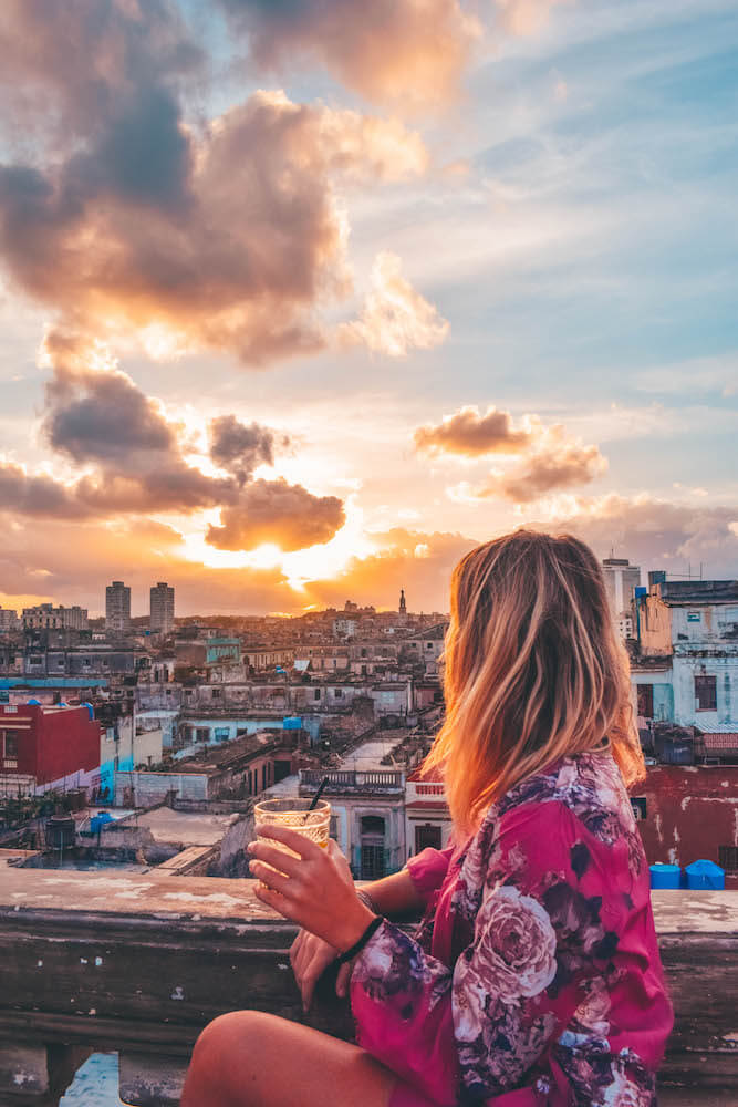 Enjoying cocktails and the sunset over Havana from the rooftop bar of the Paladar la Guarida