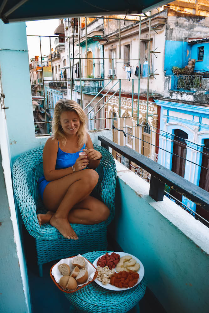 Enjoying breakfast in our AirBnb with a view over the colonial buildings of Havana, Cuba
