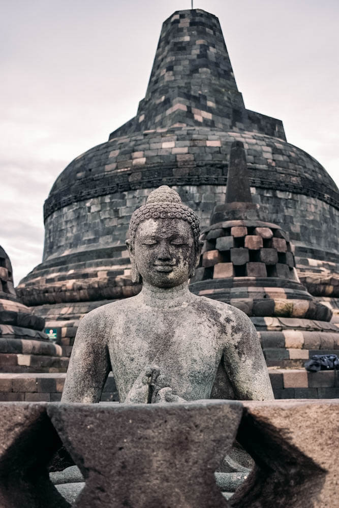 The buddha statues that are hidden inside every stupa of Borobudur