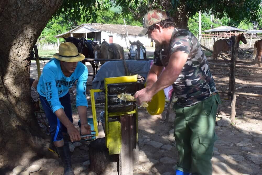 A sugar cane drink being prepared fresh in Trinidad, Cuba