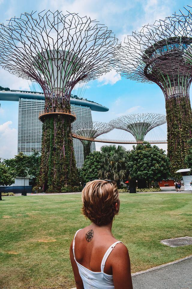 Admiring the Supertree Grove with Marina Bay Sands behind it
