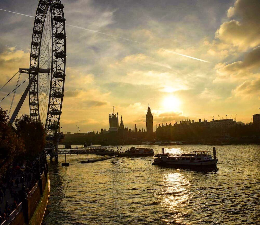 Golden hour over the London Eye and Westminster in London, UK