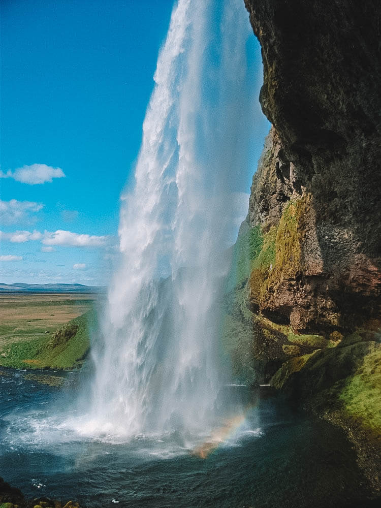 Behind Seljalandsfoss, photo by The Tinberry Travels