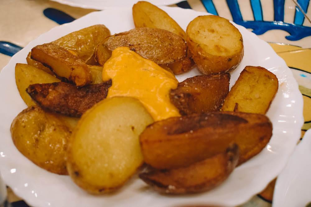 Patatas Bravas with their secret recipe sauce