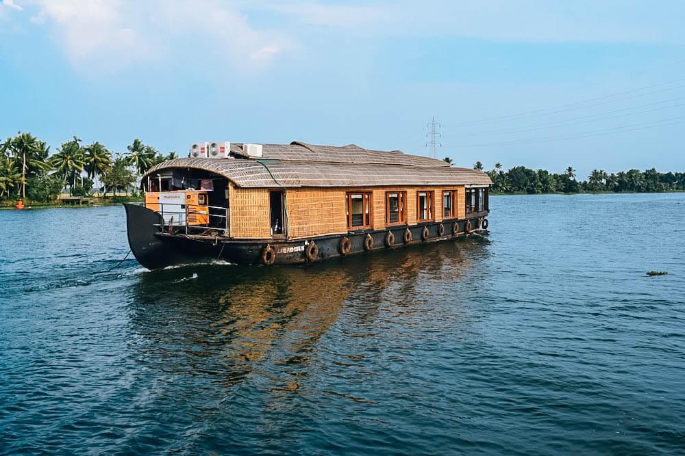 A typical kettuvallom boat cruises the backwaters of Kerala, India