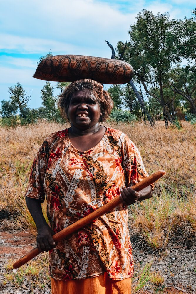 Our Anangu guide with some of the traditional aboriginal tools the women used