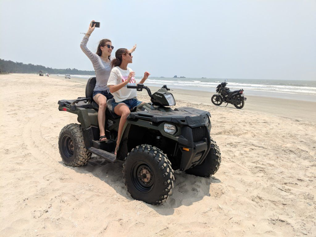 Amandine (Les Berlinettes) and Maria (Travelling Buzz) quad biking on the beach in Kannur