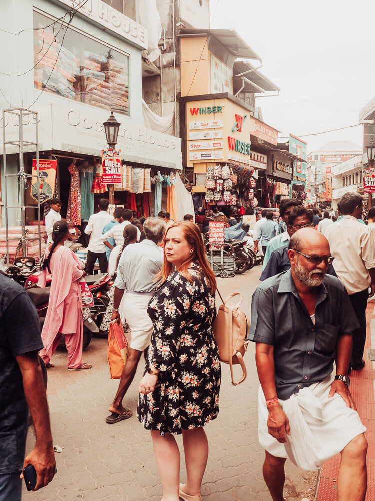 Nicola, author of All About Rosa Lilla, wandering the streets of Kerala, India