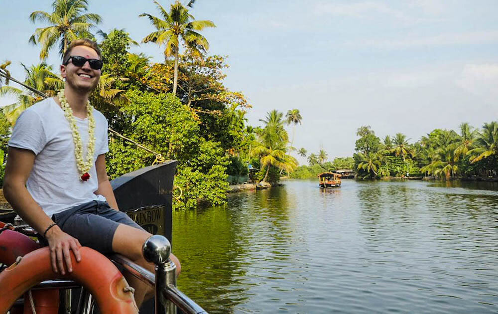 Patrick, author of the blog German Backpacker, while cruising the backwaters of Kerala, India
