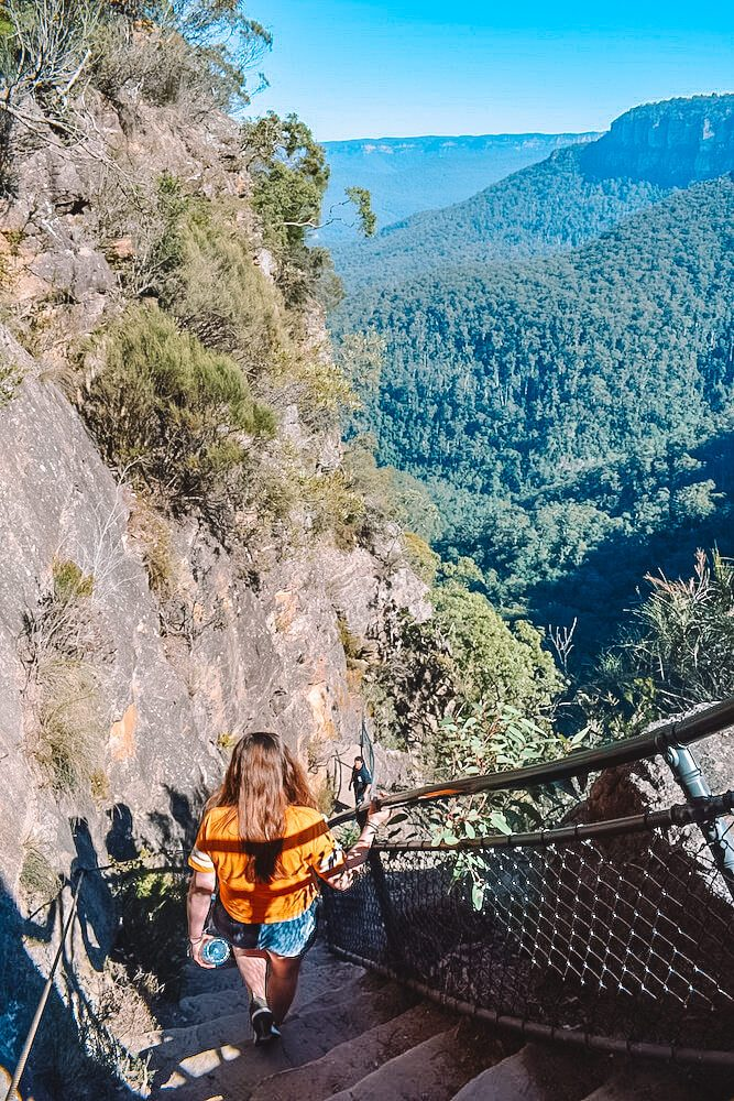 Hiking down the 900 steps to the base of Wenworth waterfall in Blue Mountains, Australia
