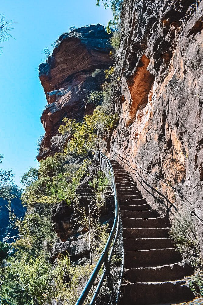 Hiking back up the 900 steps to the base of Wenworth waterfall in Blue Mountains, Australia