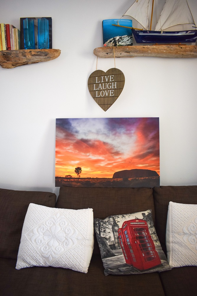Sunrise over Uluru printed on canvas and displayed in my living room