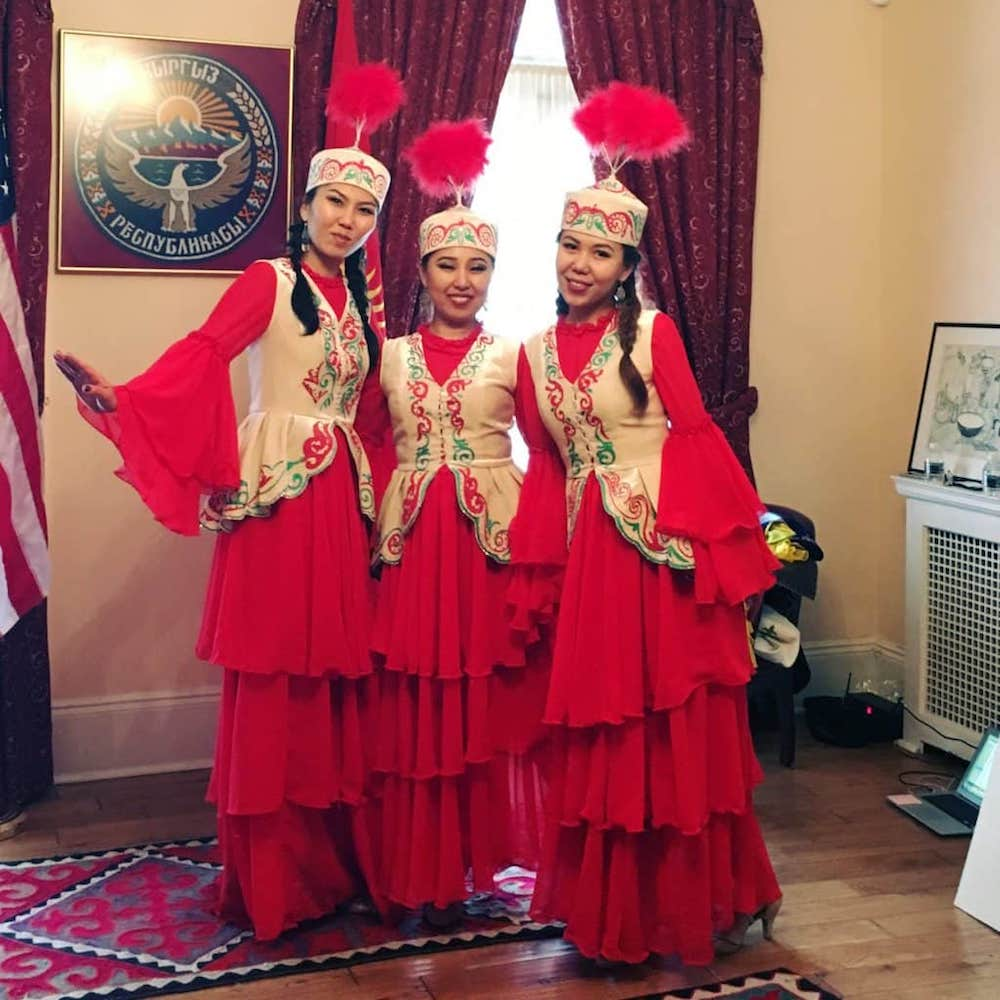 Ladies in native dress at the Embassy of Kyrgyzstan, photo by Travel As Much