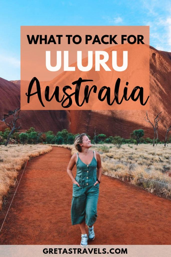 """Girl walking at the base of Uluru with text overlay saying """"what to pack for Uluru, Australia"""""""