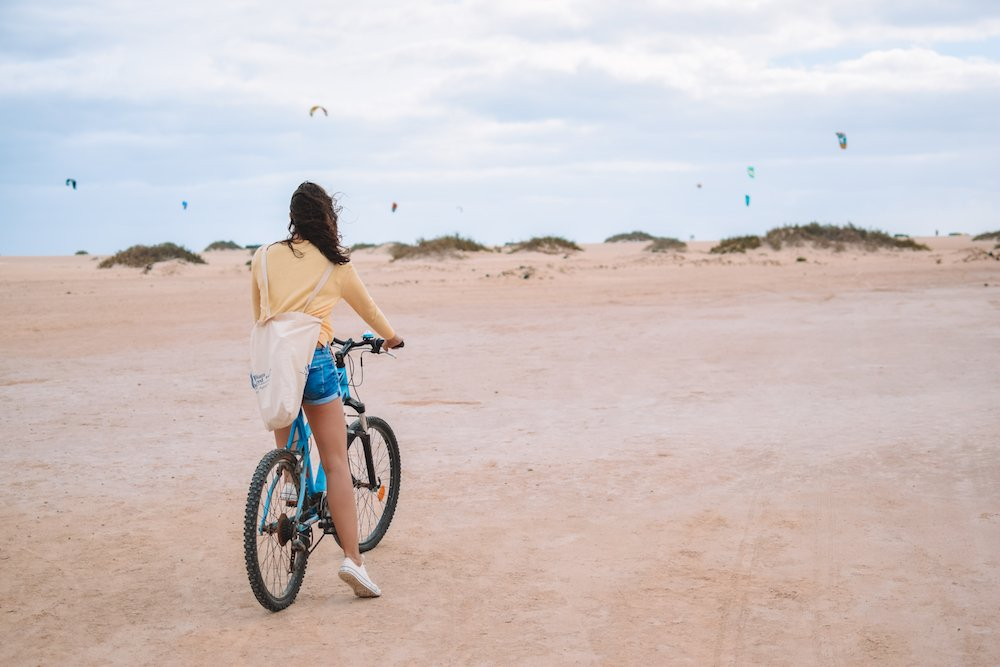 Cycling around the sand dunes of Corralejo Natural Park, Fuerteventura