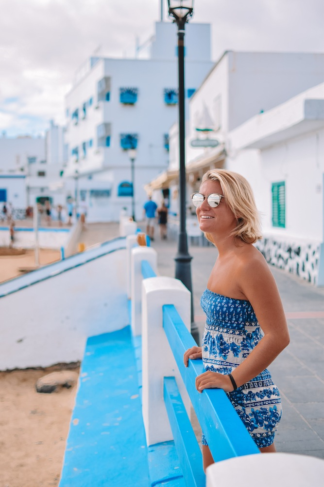 Girl overlooking the beach in Corralejo, Spain