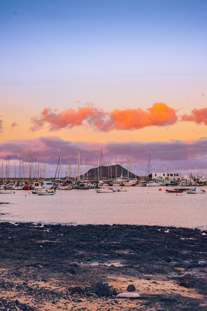 Sunset over the harbour of Corralejo, with Lobos Island in the distance
