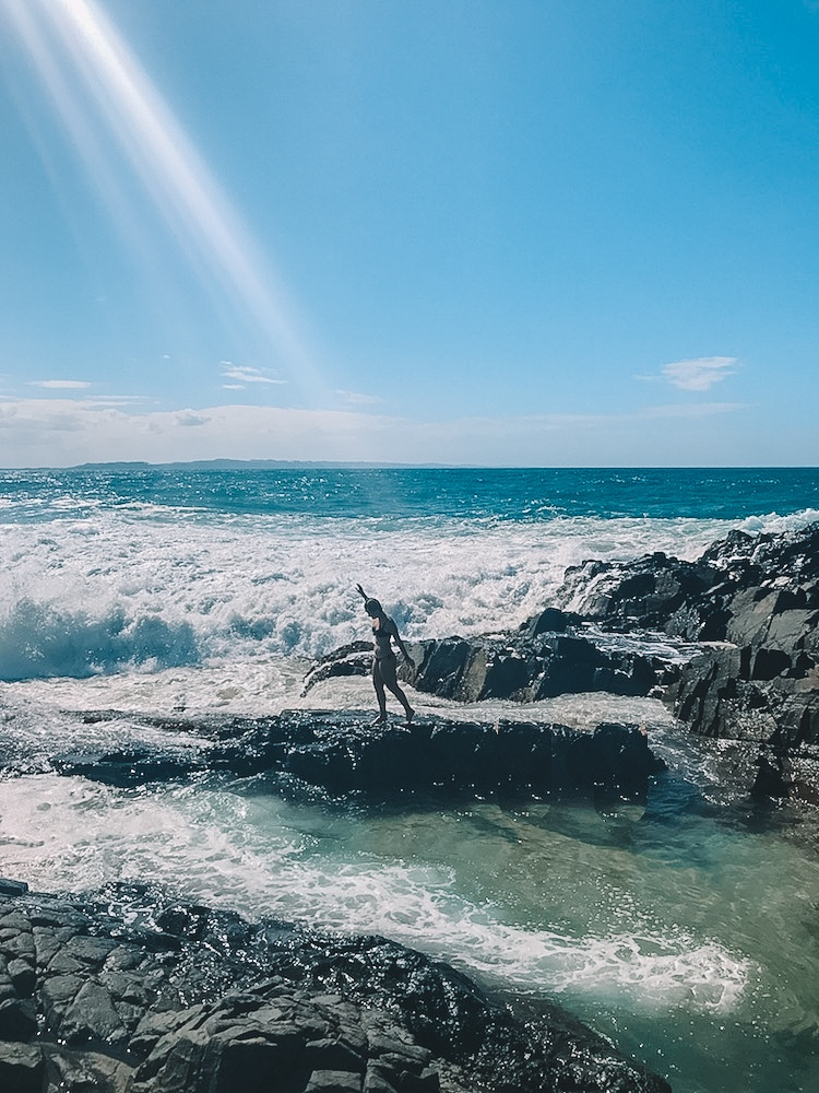 Ocean waves coming into the fairy pools at Noosa Heads