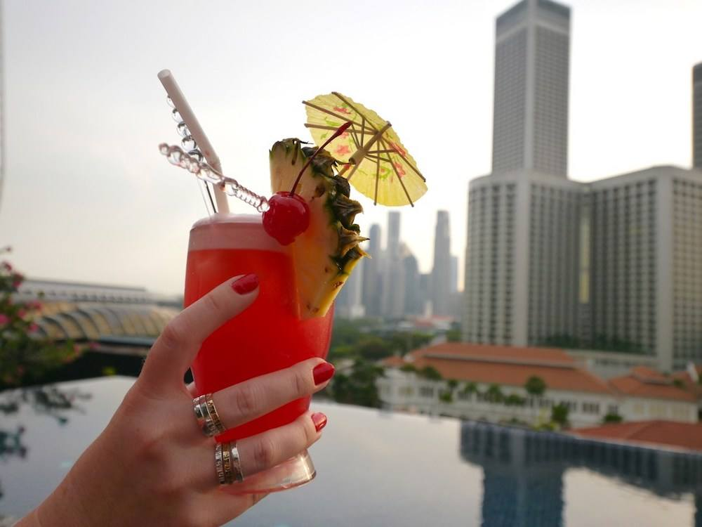 Evening cocktails at the rooftop pool of Naomi Hotel, photo by Once In A Lifetime Journey