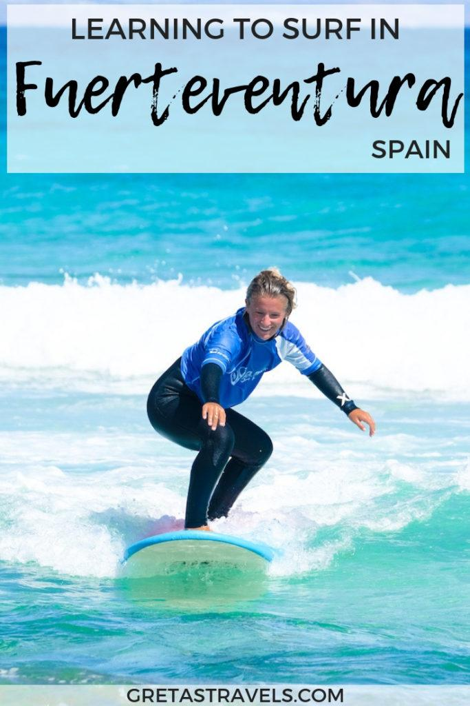 """Photo of a blonde girl surfing with text overlay saying """"learning to surf in Fuerteventura, Spain"""""""