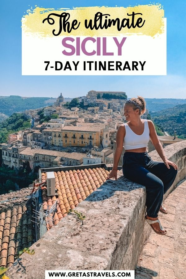 """Photo of a blonde girl sitting on a rock wall enjoying the view over Ragusa Ibla with text overlay saying """"The ultimate Sicily 7-day itinerary"""""""