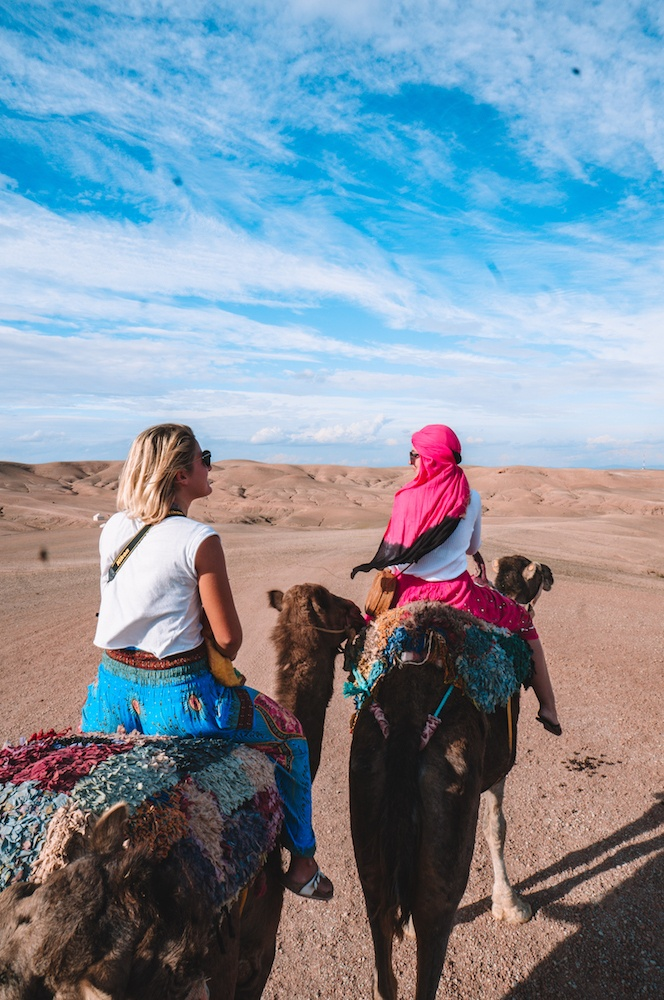 Going for a camel ride in the Agafay desert at Scarabeo Camp, Morocco