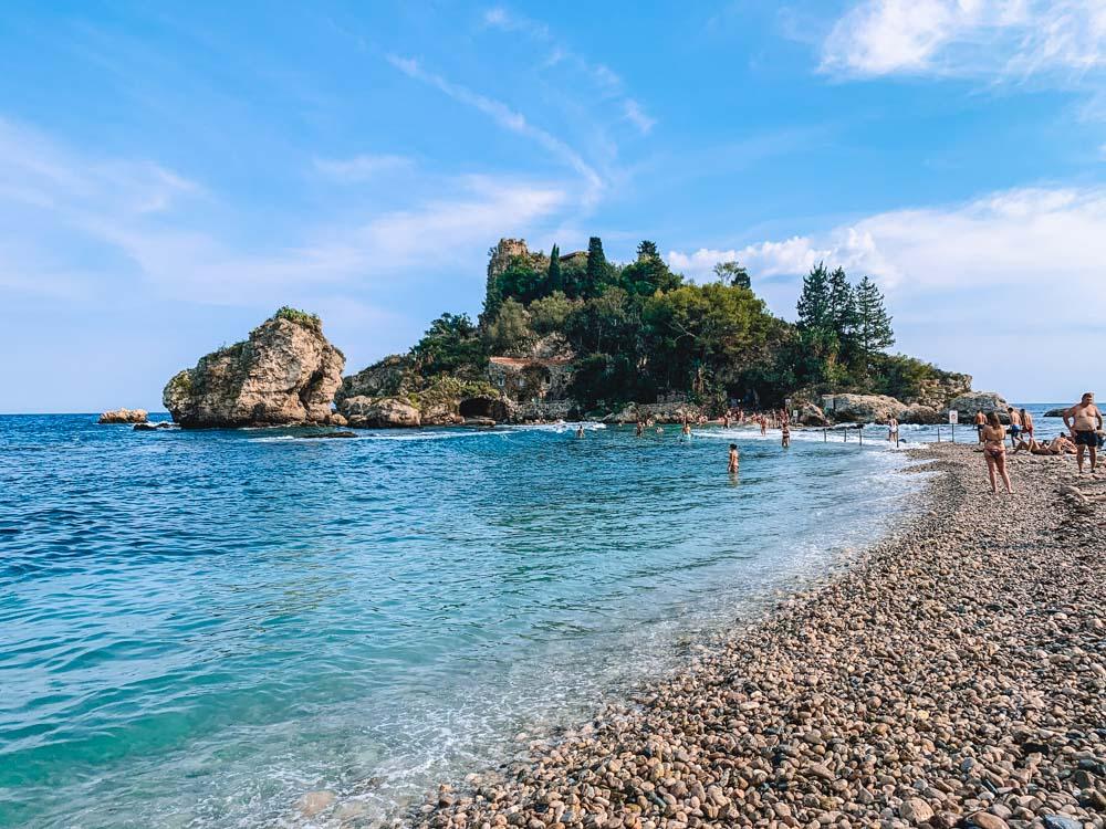 Relaxing at the beautiful Isola Bella beach in Taormina