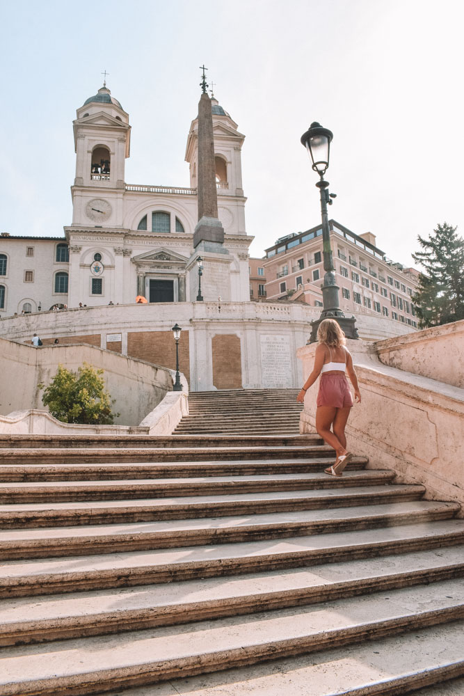 Wandering up the famous Spanish Steps towards Trinità dei Monti in Rome
