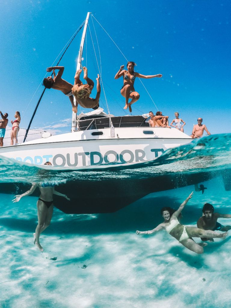 50 / 50 shot of my friends jumping from the catamaran of our Maddalena Archipelago boat tour